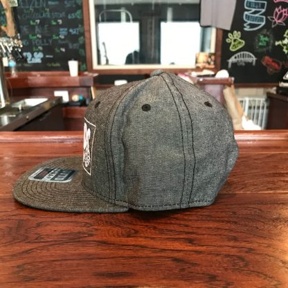 gray flat brim hat side view